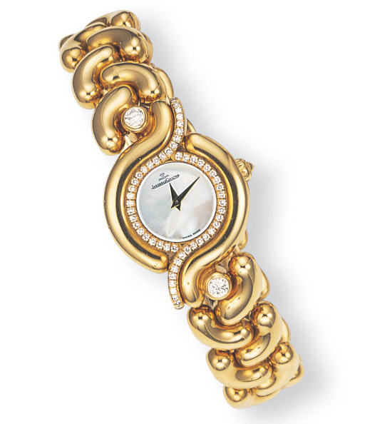 A LADY'S 18K GOLD AND DIAMOND