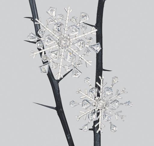 A PAIR OF DIAMOND SNOWFLAKES B