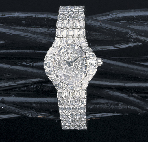 A LADY'S DIAMOND AND 18K WHITE