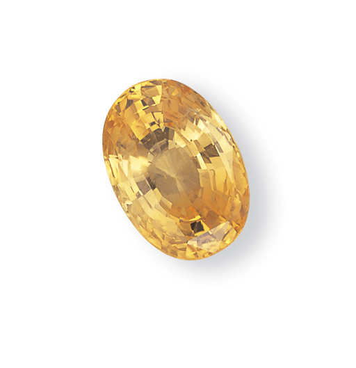 AN UNMOUNTED OVAL-CUT YELLOW S