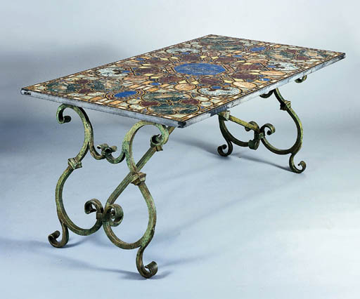 AN IRON AND PIETRA DURA TABLE