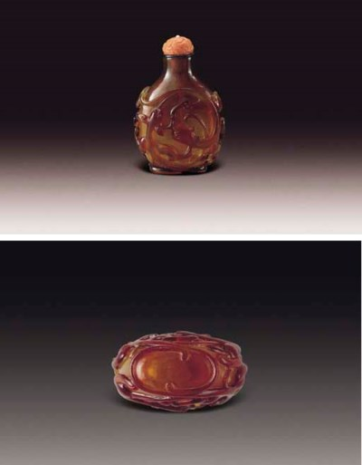 A FINELY-CARVED AMBER-BROWN GL