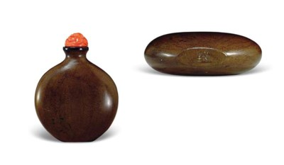AN INCISED BROWN-LACQUERED WOO