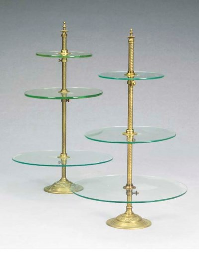 A PAIR OF BRASS AND GLASS THRE