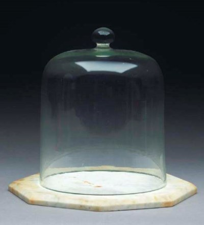 A GLASS CHEESE DOME WITH MARBL