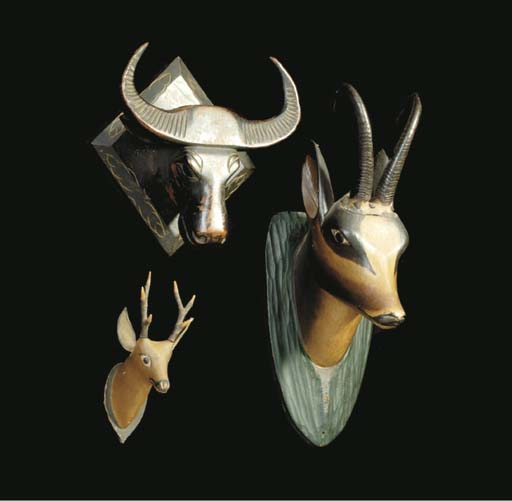 A GROUP OF THREE POLYCHROME-DECORATED STAGS HEADS TOGETHER WITH A CARVED HEAD OF A WATER BUFFALO,