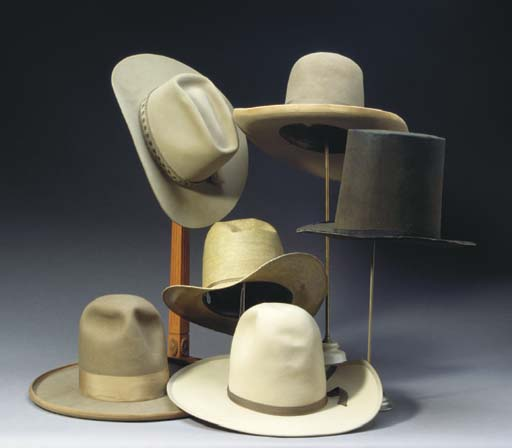 A GROUP OF SIX GENTLEMAN'S HATS TOGETHER WITH FOUR VARIOUS HAT-STANDS,