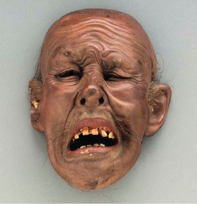 A Lacquer and Wood Mask of a G