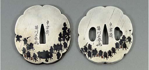 A Silver Daisho (Pair of Tsuba)