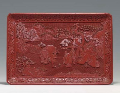 AN UNUSUAL CARVED RED LACQUER