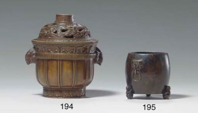 A BRONZE INCENSE BURNER AND RE