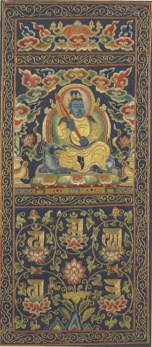 A FINE AND RARE EMBROIDERED THANGKA OF YAMA