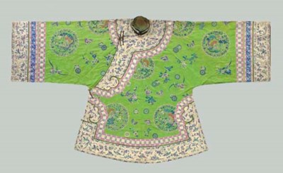 AN EMBROIDERED GREEN SILK LADY