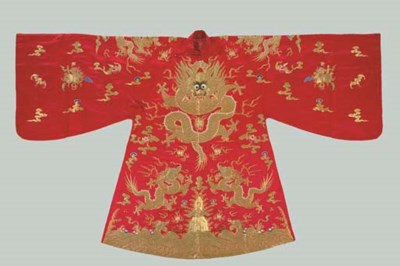 AN EMBROIDERED RED SILK BRIDAL
