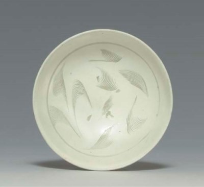 A SMALL CIZHOU BOWL WITH COMBE