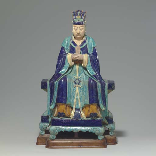 A GLAZED TILEWORK'S FIGURE OF A SEATED OFFICIAL
