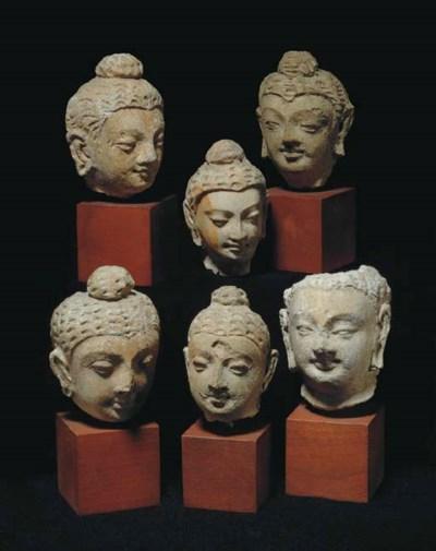 Six Small Stucco Heads of Budd