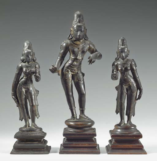 A Rare Bronze Group of Krishna the Regal Cowherd with Consorts