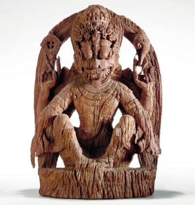 A Carved Wood Figure of Narasi