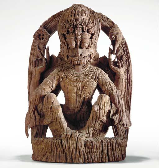 A Carved Wood Figure of Narasimha