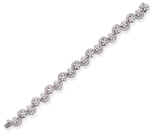 A DIAMOND BRACELET, BY OSCAR H