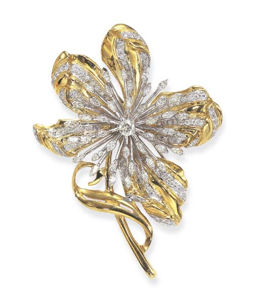 A GOLD AND DIAMOND BROOCH