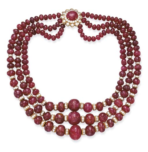 A THREE-STRAND RUBY AND DIAMON