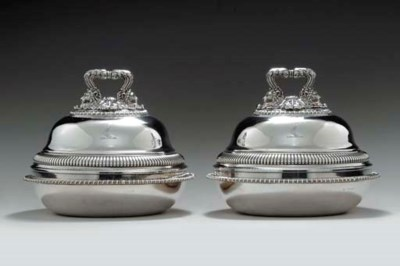 A PAIR OF REGENCY SILVER COVER