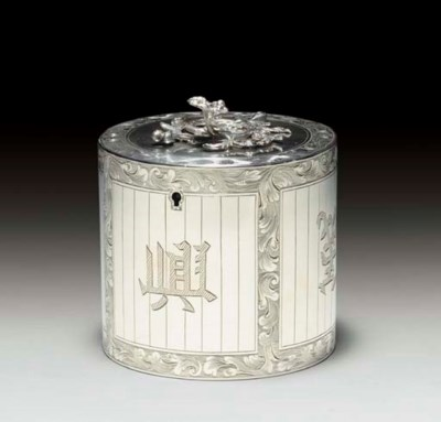 A GEORGE III SILVER TEA CADDY