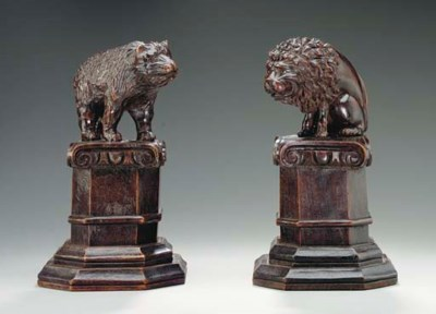 A PAIR OF WALNUT FIGURES OF A