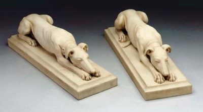A pair of white marble recumbe