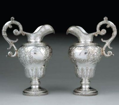 A PAIR OF SILVER WATER PITCHER