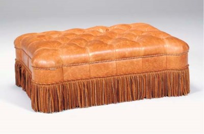 A BROWN TUFTED LEATHER OTTOMAN