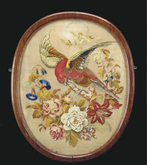 A LARGE BERLINWORK EMBROIDERY OF A PARROT IN OVAL FRAME,