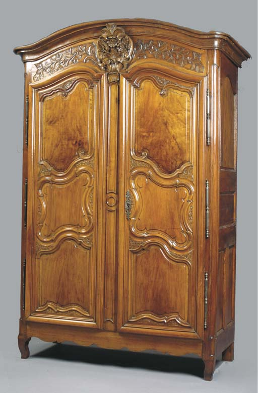 A LOUIS XV PROVINCIAL WALNUT ARMOIRE,
