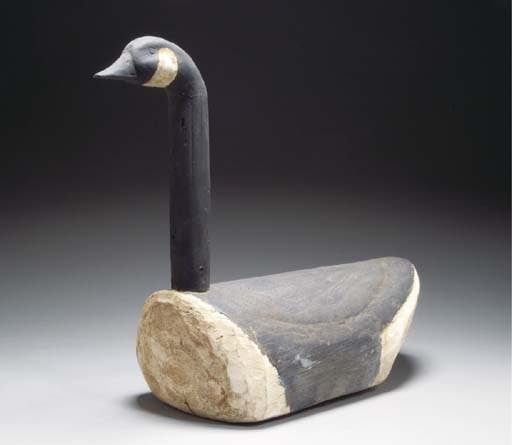 TWO ROUGH HEWN AND PAINTED WOOD DECOYS OF CANADIAN GEESE,