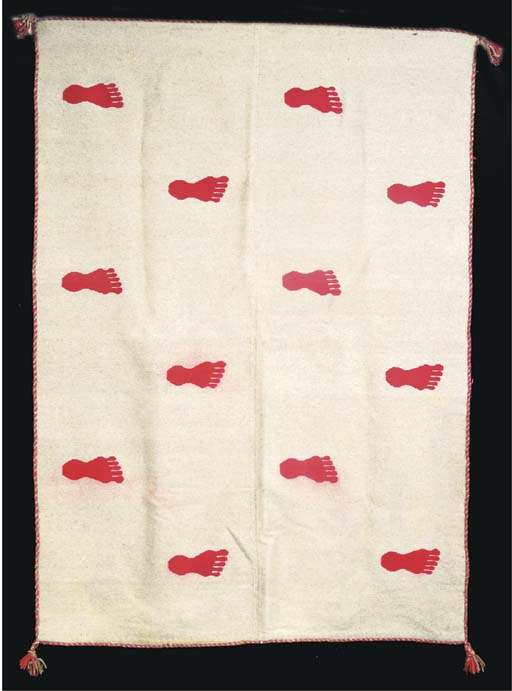 A BROWN AND RED WOOL BLANKET WITH FOOTPRINT MOTIF,