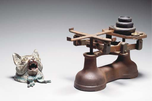 AN IRON BALANCE SCALE AND WEIGHTS TOGETHER WITH A COLD PAINTED IRON KITTEN-FORM INKWELL,