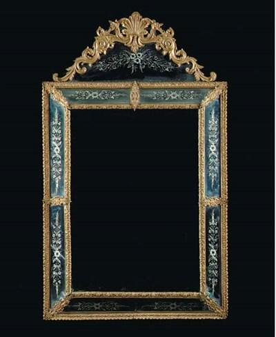A REGENCE STYLE GILT METAL AND