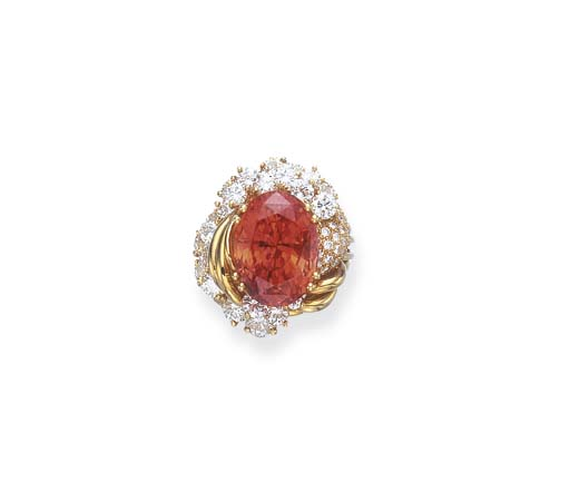 AN EXTREMELY RARE PADPARADSCHA SAPPHIRE AND DIAMOND RING, BY HENRY DUNAY