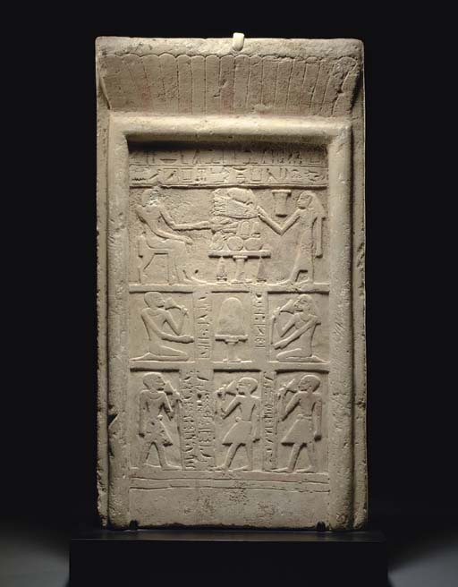 AN EGYPTIAN LIMESTONE STELA FO