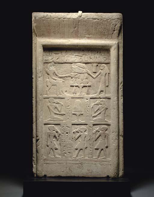 AN EGYPTIAN LIMESTONE STELA FOR SA-HATHOR