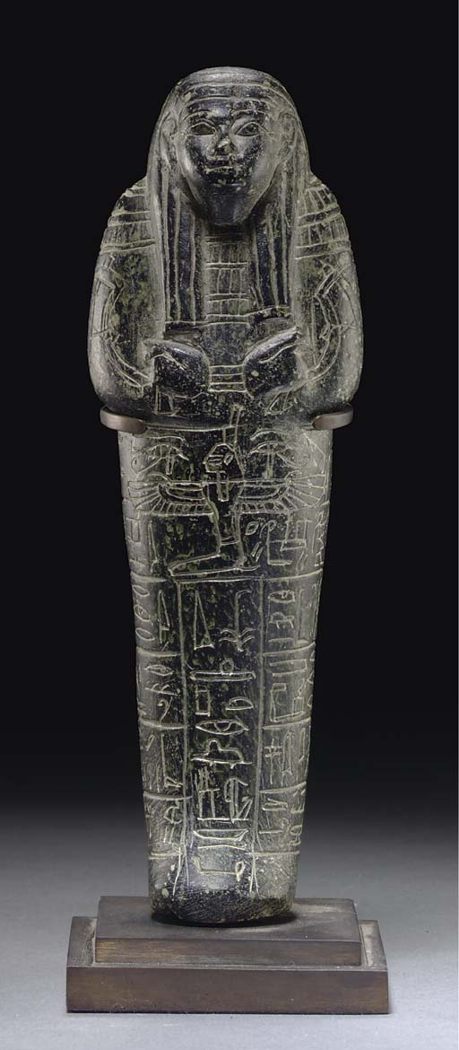 AN EGYPTIAN SERPENTINE SHABTI