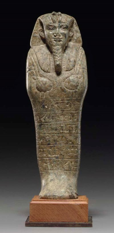 A NUBIAN SERPENTINE SHABTI FOR