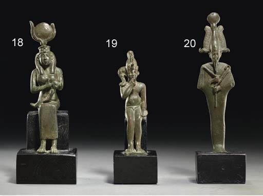AN EGYPTIAN BRONZE HARPOKRATES