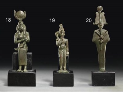 AN EGYPTIAN BRONZE HARPOKRATES