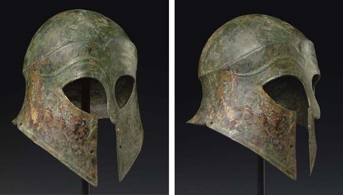 A GREEK BRONZE CORINTHIAN HELM