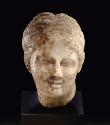 A GREEK MARBLE HEAD OF A GODDE