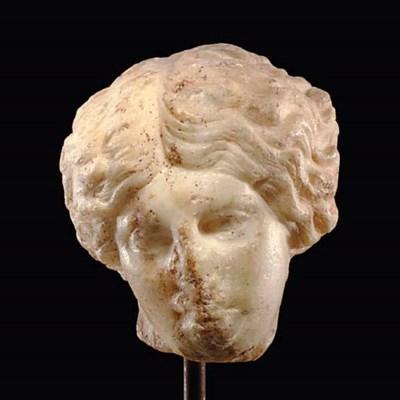 A ROMAN MARBLE HEAD OF AN AMAZ