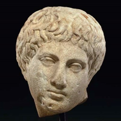 A ROMAN MARBLE HEAD OF NARCISS